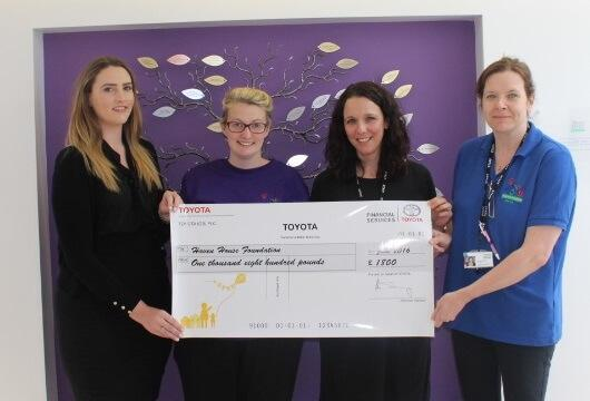 Haven House staff and Toyota Centre Host being presented with cheque